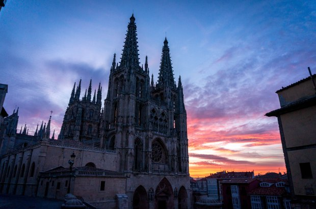 "We caught the sunrise surrounding the cathedral in Burgos as we road out of the city early one morning. As we exited the city the air was crisp and the streets were quiet except for the trickling of pilgrims saying ""buen camino"" as we passed."