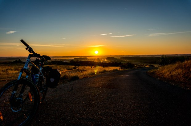 We had many beautiful sunrises. Each day we would ride out of small towns or big cities away from the sunrise. My favorite was staying in small towns so we could see the sunrise in more remote and open spots along the trail. This is a great shot with the bike.